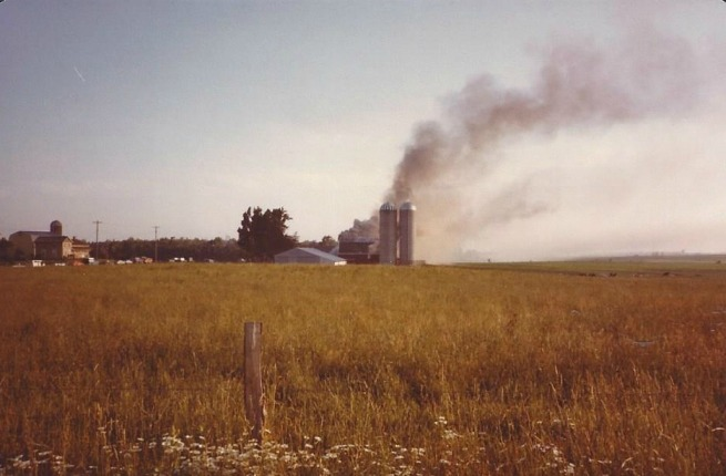 Our farm would look idyllic, if it wasn't for the cloud of smoke pouring from our barn